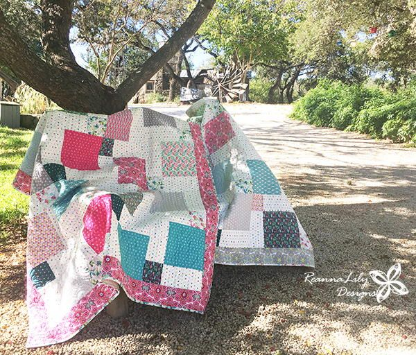 Layer Cake Disappearing 9-Patch Baby Quilt | Break out your layer cakes for this fun weekend quilt project!