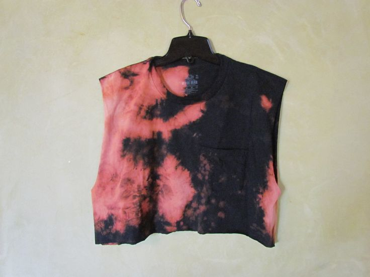 This is a unique, handmade, tie dye T-shirt. ONE SIZE FITS ALL! This T-shirt will fit you! For exact measurements please feel free to contact me. It has a really cool splatter, bleach effect on it and looks super cool on.