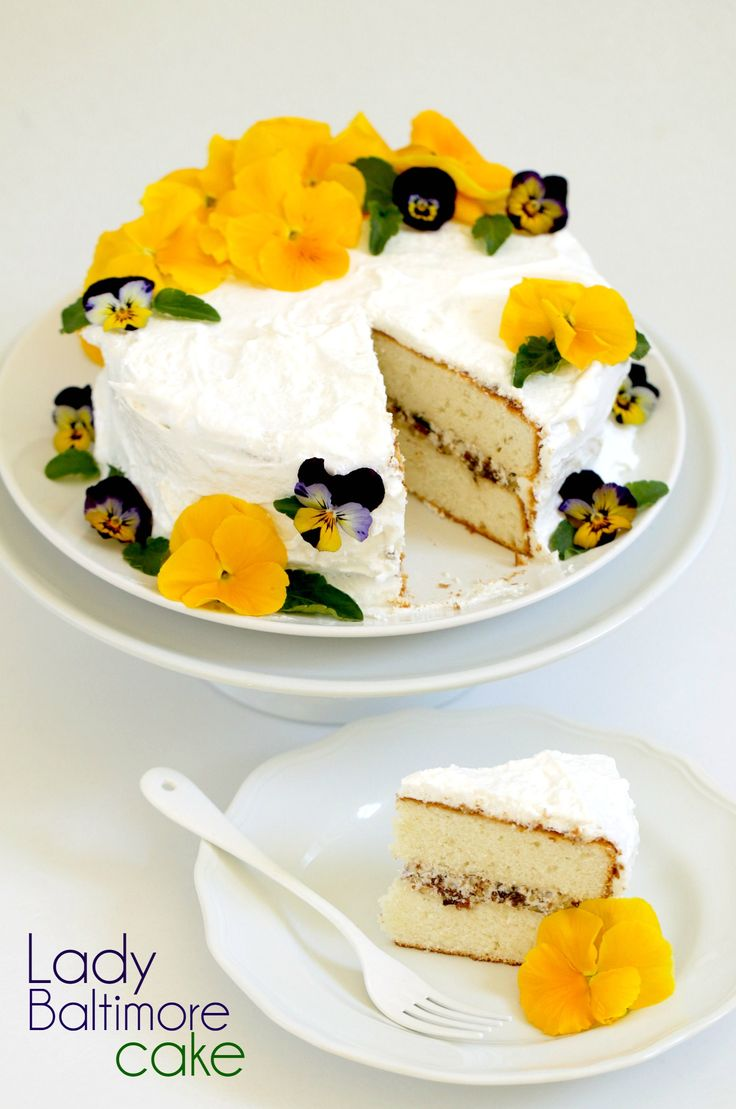 This gorgeous Lady Baltimore cake was made from a vintage recipe! Then I used it as inspiration to make a much easier version. Click through to see a hilarious video on how I made both desserts!