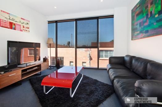 2/2 Stuart Street, Balaclava, Melbourne. Note. the owner of Espresso Apartments gives a big thumbs up for this apartment for the right guest. There are stairs and no lift and it is located in a semi industrial lane behind Carlisle St. However, the apartment is super luxurious, and is situated high up with a cool outlook and the location tucked away behind ultra cool Carlisle St is brilliant.