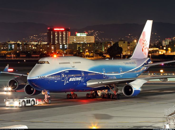 """A night shot of China Airlines """"Dynasty Dreamliner"""" 747 being readied for…"""
