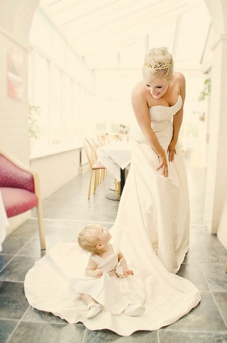 @Michelle Pickens   (with Emma--- in red on your white dress)  Bride looking down at baby flower girl sitting on floor