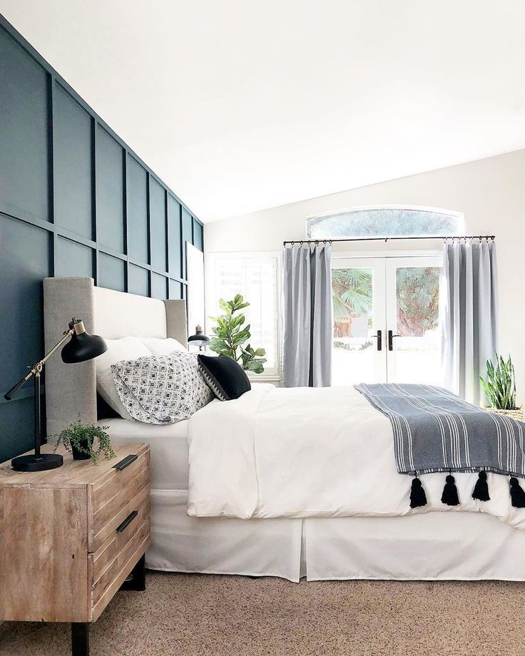 Panel Walls With Dark Paint And Beautiful Neutral Bedding