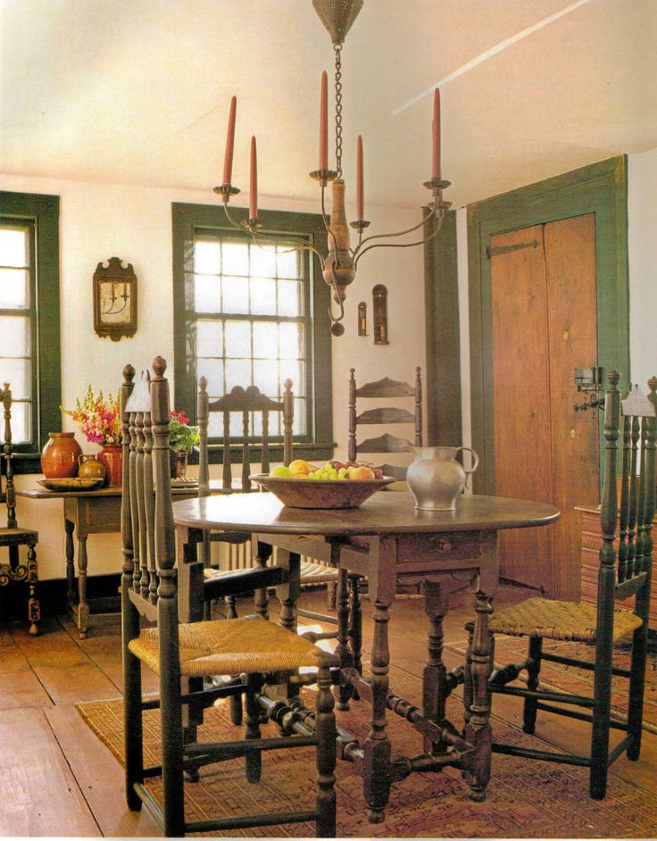 gate leg table, ladder back chairs, simple candle light, plain windows, long door hinges & a lift latch…. so sweet!