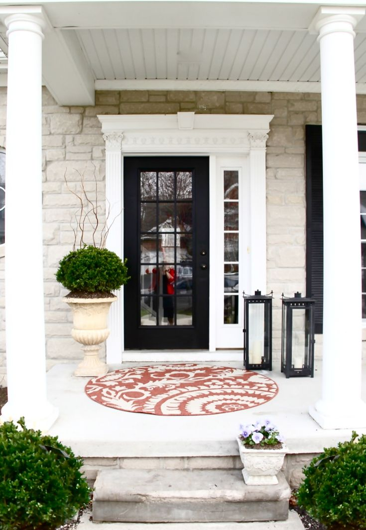 Front Porch by The Yellow Cape Cod. I love how she uses large scale items to create the most impact on her front porch. The large planter, lanterns, and rug all came from Sam's Club.