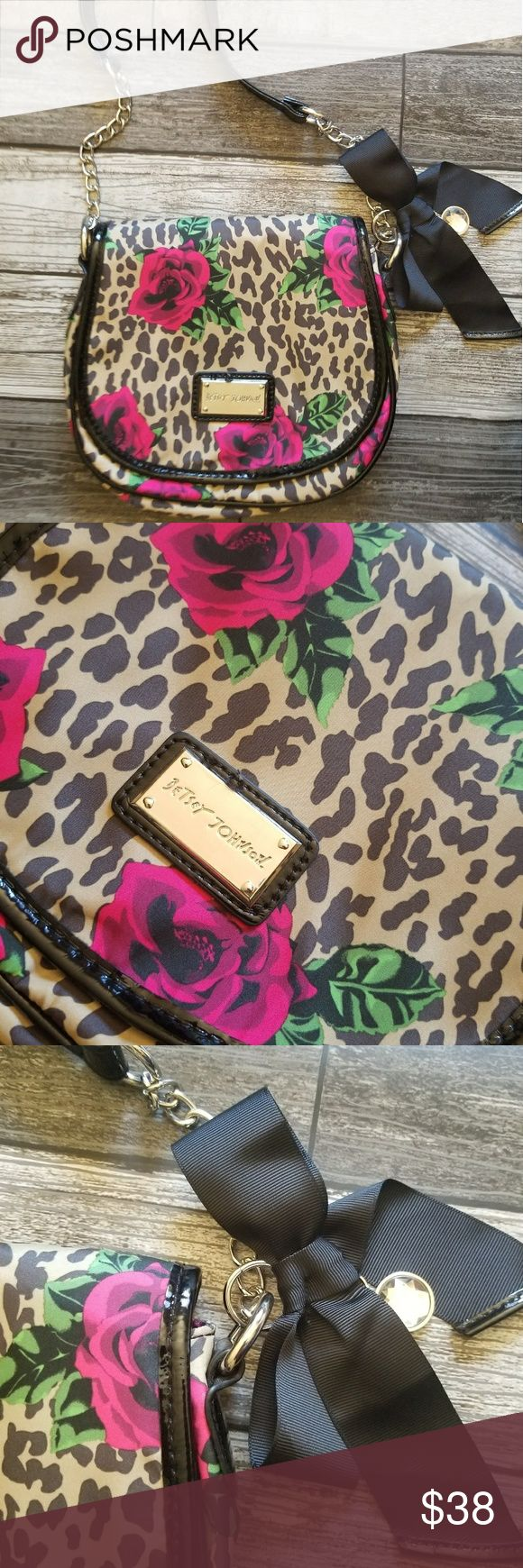 BETSEY JOHNSON leopard rose crossbody Leopard /cheetah with roses print flap crossbody. Lining is black patent faux leather. Strap is combo of chain and faux patent. Great condition Betsey Johnson Bags Crossbody Bags