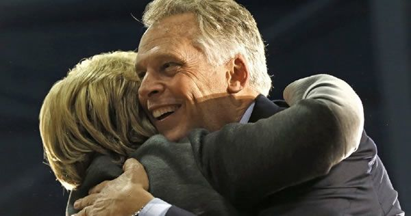 Virginia Gov. Terry McAuliffe, an important ally of Democratic nominee Hillary Clinton, funneled nearly $700,000 in donations and support to the campaign of the spouse of an FBI official who then o…