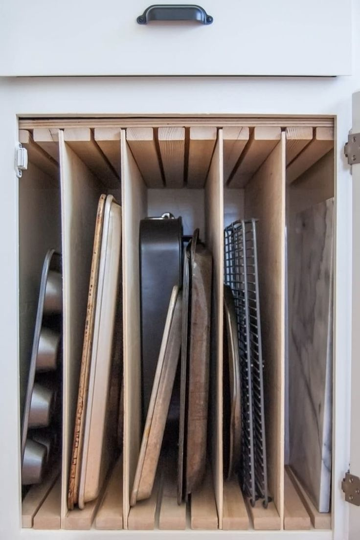 DIY kitchen storage solutions can totally transform your kitchen if done right! Storing baking pans and sheets vertically versus stacking them is like the difference between filing and piling paper. They're so much easier to access when stored vertically, so if you have a lot of baking pans, try this hack.