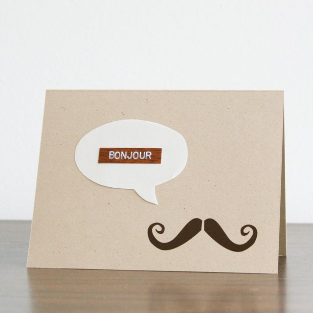 Inspiration: bonjour card using woodgrain Dymo tape.