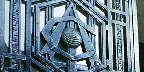 "The Art Deco crest on the Highbury doors. The hexagonal Art Deco ""A-football-C"" symbol has been synonymous with Arsenal Football Club since the 1930's"