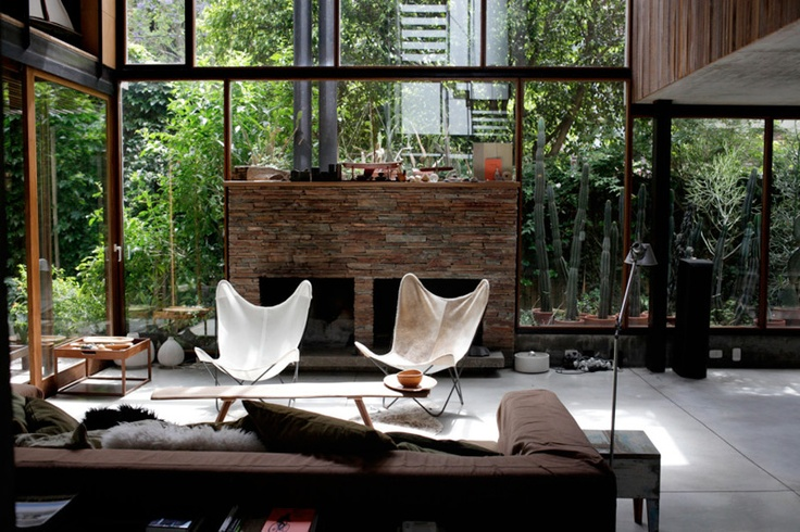 Glass walls, nature as the background and wood tones in the decor.