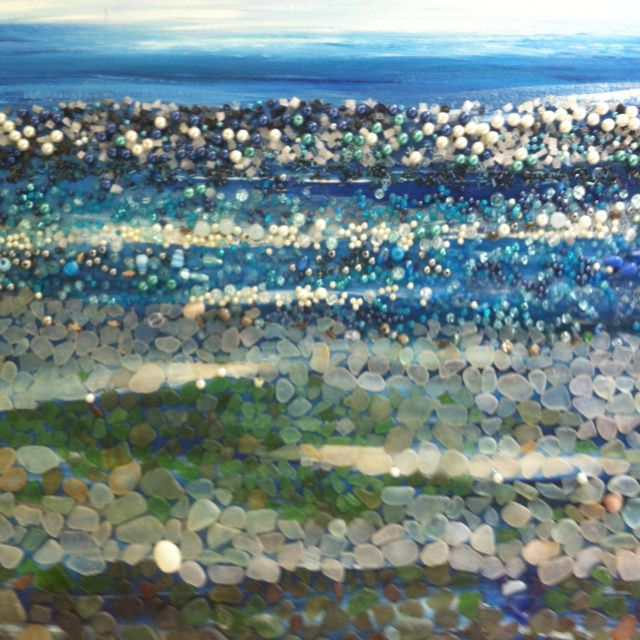 Sea glass art /artwork but I love the texture created with the beads and the sea glass.