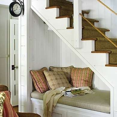 Cozy Reading Nook  A simple banquette piled with pillows and lit from above with a wall sconce is a tempting spot to curl up with a favorite book. Drawers or cabinets below provide additional storage for the room.