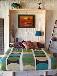 Lori Wall Beds DIY Affordable Murphy Bed Alternative-plans for $18. Beds have no spring mechanism, you simply raise the bed up and clip it vertically. Could add a pull down table top to create a desk.