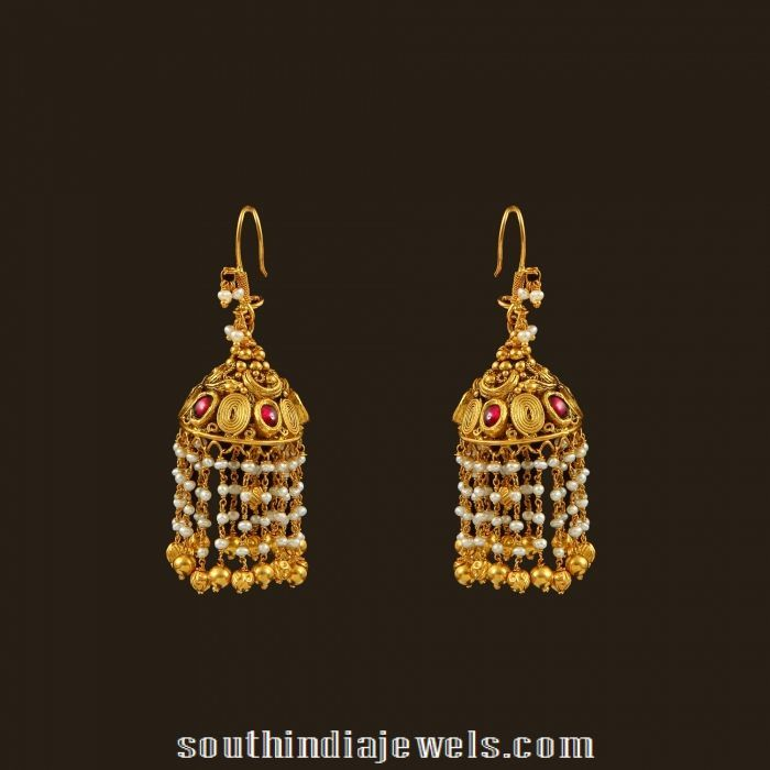 Gold antique hook style pearl drop earrings.