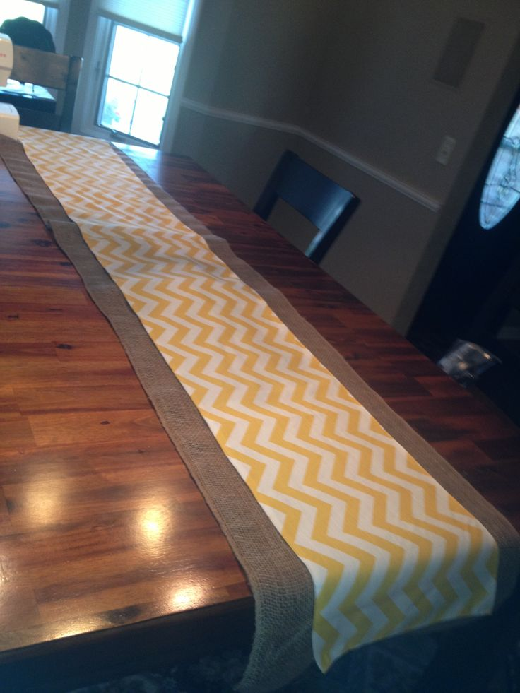 Homemade table runner.... Burlap then sewed a yellow runner to lay on top
