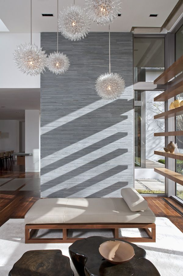 Love the lighting, the textural wall and the shelving over the large windows. Interiors by Meg Joannides, Architecture ?, Photography by MLK Studio.