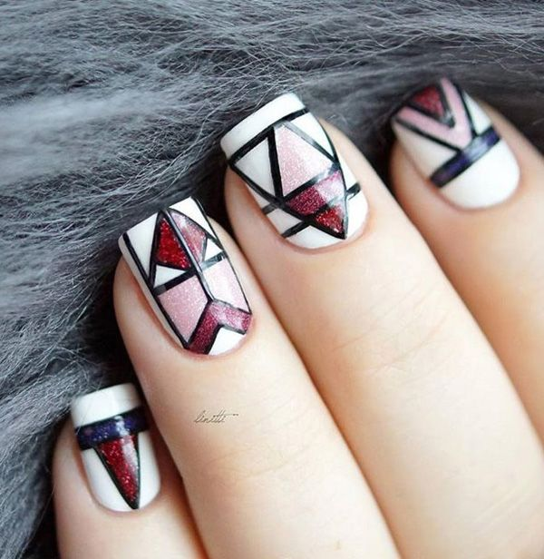 Red, pink and blue glitters polish themed spring nail art design. The abstract design of this nail art looks absolutely gorgeous with the help of white and black polish to separate the colors.