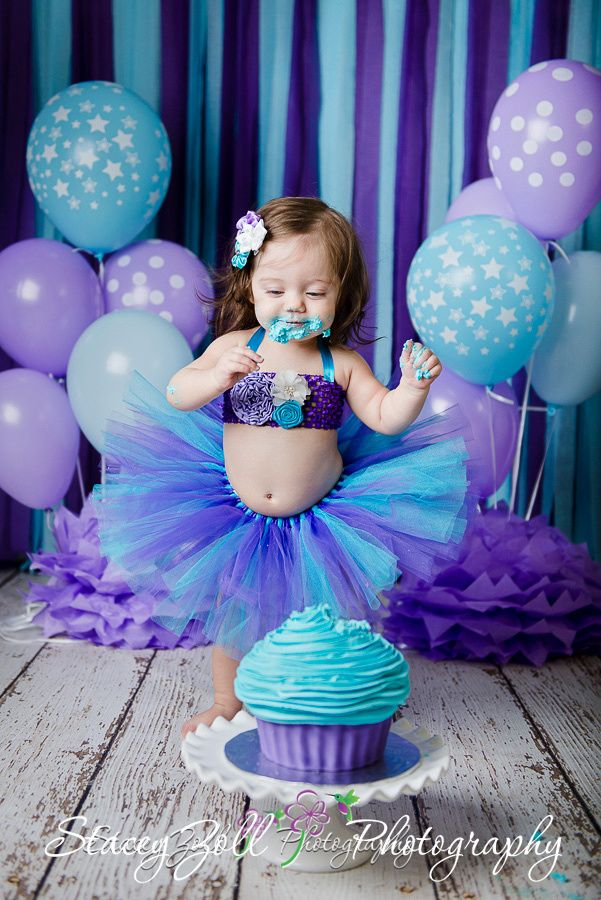 Cake Smash , Puprle & Teal / Blue , giant cupcake, Streamer backdrop , paper flowers , balloons , Tutu outfit.  Manhattan, Kansas Photographer @Stacey Zoll Photography , staceyzphotography.com