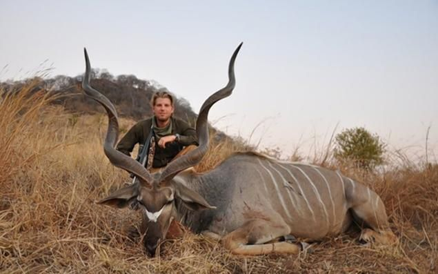 Eric Trump is pictured with an animal he killed on a visit to Zimbabwe. It's true, the nut really doesn't fall far from the tree.