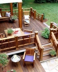 Deck to concrete porch slab with fire pit