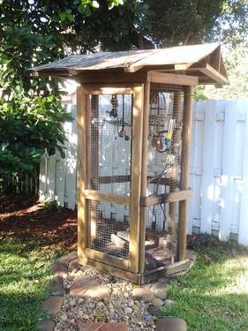 Outdoor aviary from old doors.