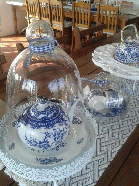 Love the teapot under glass!