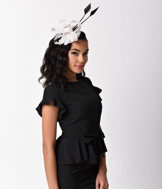 Give 'em a little 'wow'! A magnificent ivory sinamay fascinator hat boasting gorgeous black long feather detail. Set on a black satin headband for secure wear. Dumbstruck is good, dear.<br /> Available while supplies last.