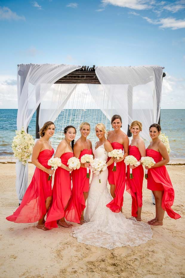 Photo of bride with bridesmaids / bridesmaids are wearing long coral dresses / Aldabella Photography