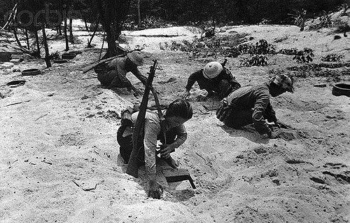 May 1967, Dong Hoi, North Vietnam --- 5/1967- Dong Hoi, North Vietnam- North Vietnamese place mines along a beach in the Dong Hoi area. This photo was made by a correspondent of Nihon Denpa News, Ltd., a Japanece news agency, in early May. BPA2#5280. --- Image by © Bettmann/CORBIS