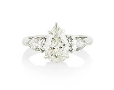 An 18ct White Gold and Pear Shaped Diamond Three Stone Ring