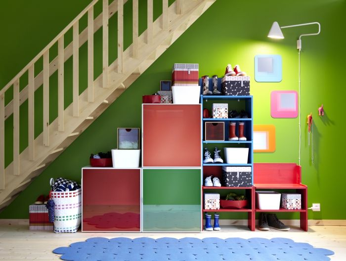 Make the most of that odd space under the stairs!  A combination of cabinets and stackable shelves do the trick!