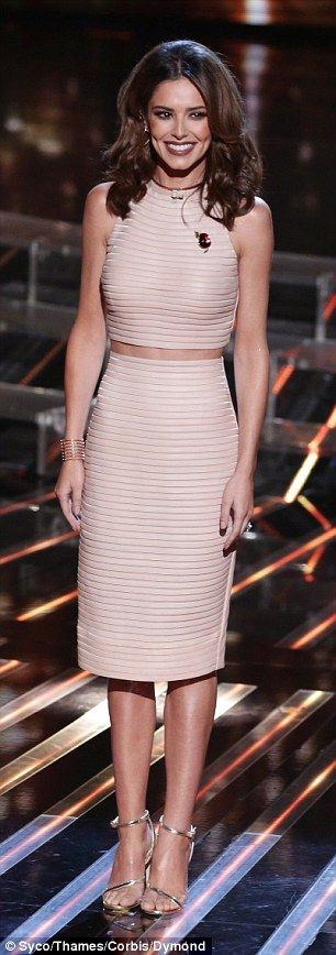 Contrasting looks: Cheryl looked elegant in her two-piece (L) while Rita showcased her unique sense of style in her more experimental number (R) for The X Factor results show on Sunday evening