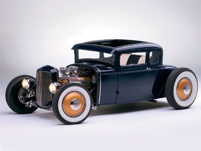 Check out this 1931 Ford Model A Coupe with 331ci 1950 Cadillac block, an Isky cam, a 1983 Chevy T5 transmission, and Hildebrandt valve covers that flank the carbs with Edmunds air cleaners inside Rod & Custom Magazine.