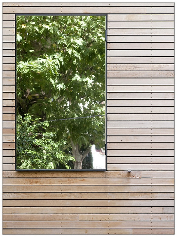 Mirrored window: Let light in, provide privacy + reflect the garden. Well done...