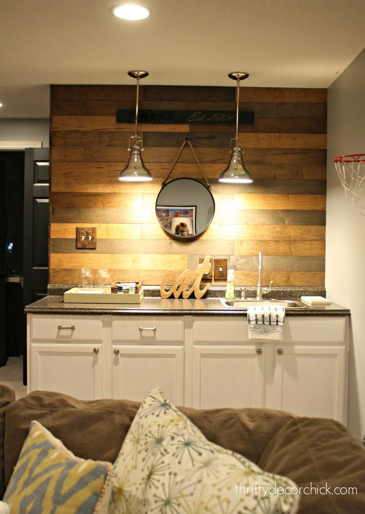 Love this wood planked wall over kitchenette.