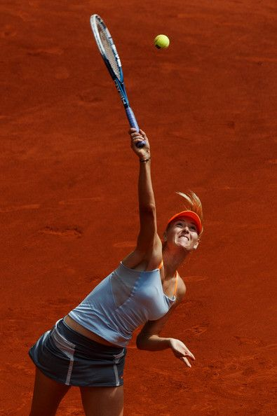 Maria Sharapova Photos Photos - Maria Sharapova of Russia serves the ball to Sabine Lisicki of Germany on day six of the Mutua Madrid Open tennis tournament at the Caja Magica on May 9, 2013 in Madrid, Spain. - Mutua Madrid Open: Day 6