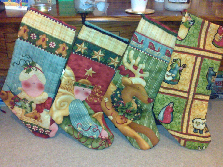 Christmas Stockings made out of quilting fabric. Fabric by Nancy Halvorsen.