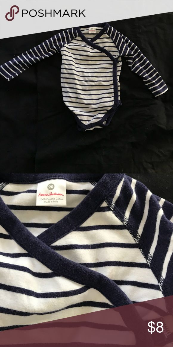 Hannah Andersson long sleeve side snap onesie Hannah Andersson long sleeve side snap onesie. Size 90 cm. Navy and white. Has small stain on right side just above the cross wrap section - see photo. Otherwise good used condition. Hanna Andersson One Pieces Bodysuits