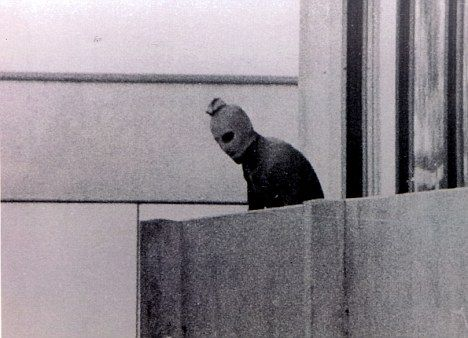 In one of the most iconic photos taken during the Munich Summer Olympics in 1972, a member of the Palestinian terrorist group, Black September, looks down from a balcony inside the Olympic Village, where 11 members of the Israeli Team delegation had been taken hostage. Before the next day could begin, all eleven would be dead.