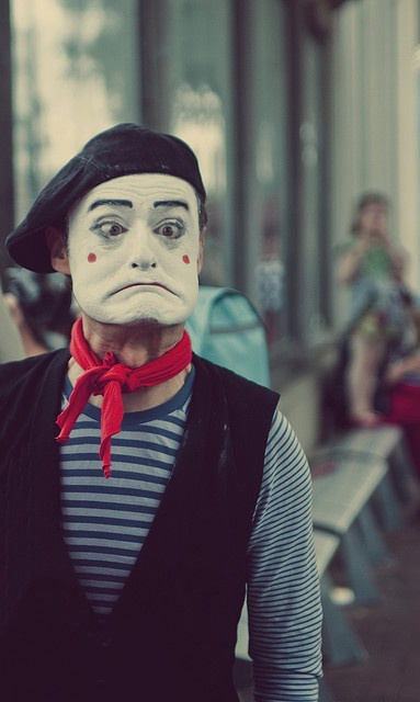 | Mime street performer striking a pose for the camera | Why do I feel like I would be related to this guy?