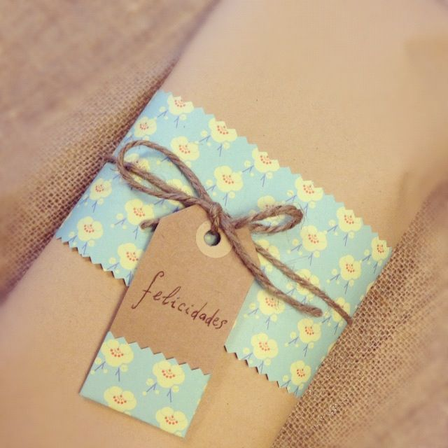 Wrap a gift with kraft paper, decorate with a scrap of patterned paper with a matching tag, tie with jute or twine - pretty!