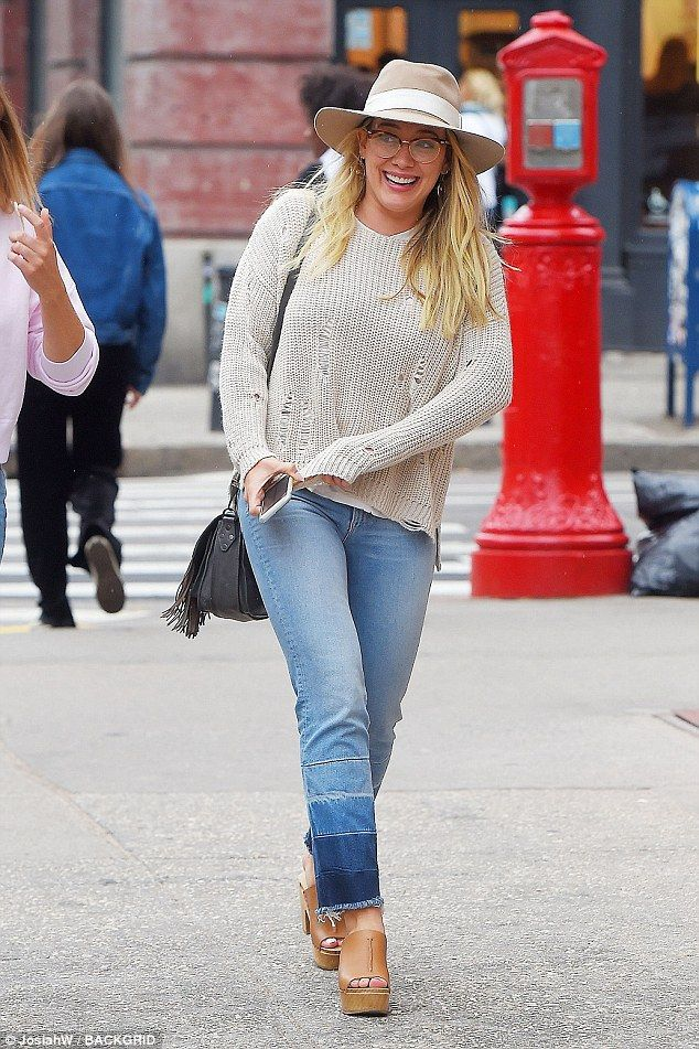 L-O-L: Hilary Duff giggled as she walked through New York City on Sunday, she is in town t...