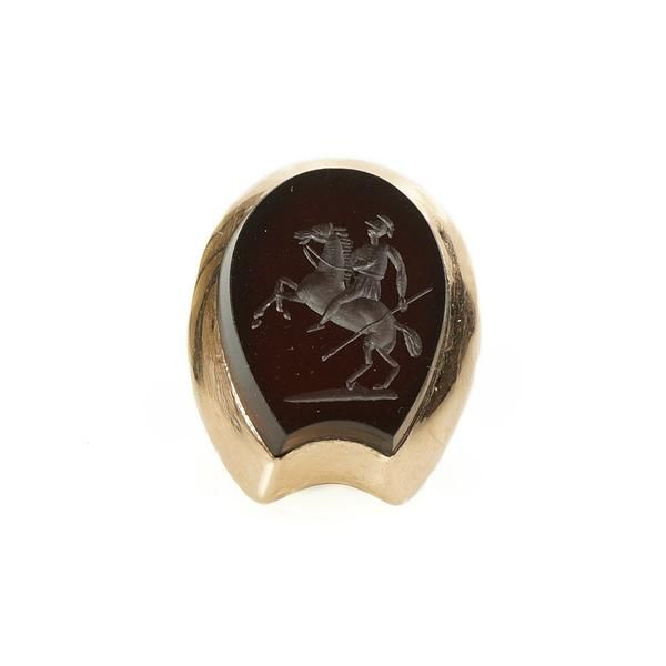 Most intaglio rings are either oval or rectangular, they rarely have such an interesting shape as a horse shoe. The intaglio of a man on a rearing horse with a