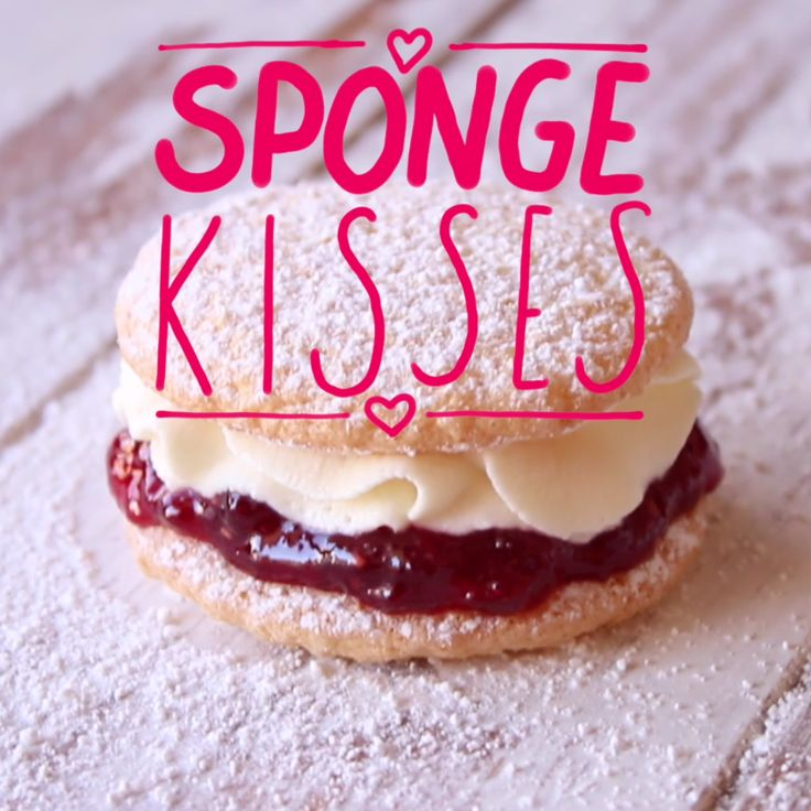 Sweet as kisses! Small round discs of delicate sponge cake with jam and fresh cream in the centre and dusting of icing sugar.