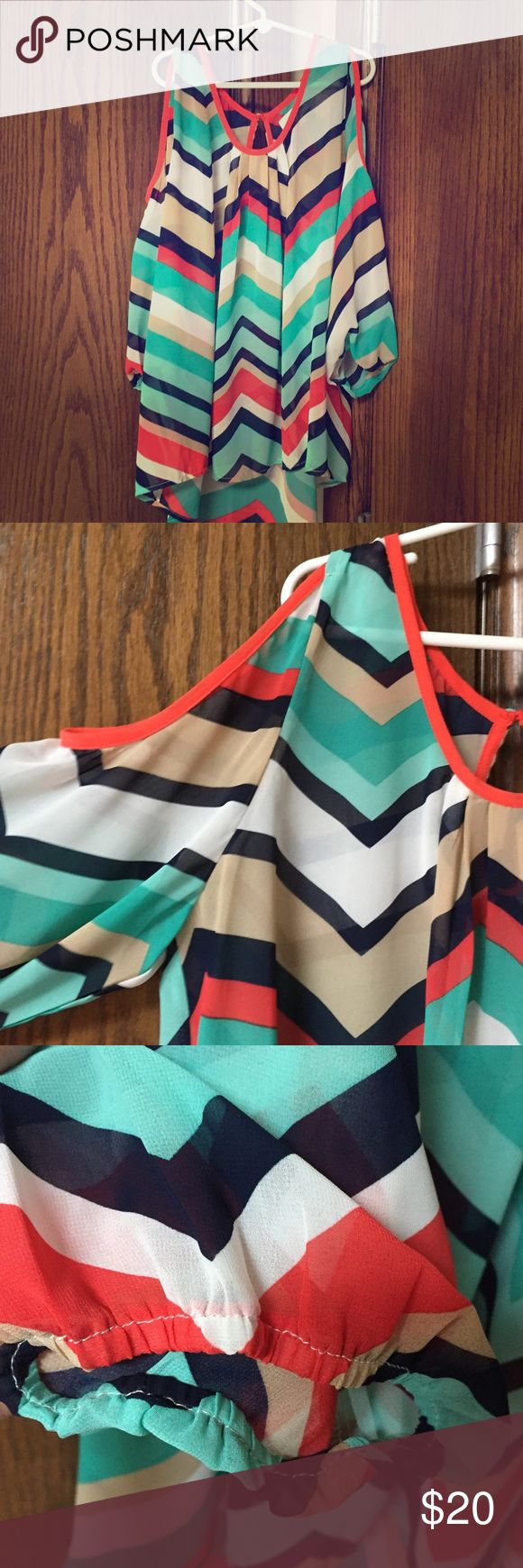 Chevron Blouse Chevron blouse with cut out shoulders, I only wore this a few times so condition is great, there are no obvious signs of wear. Fits true to size. Tops Blouses