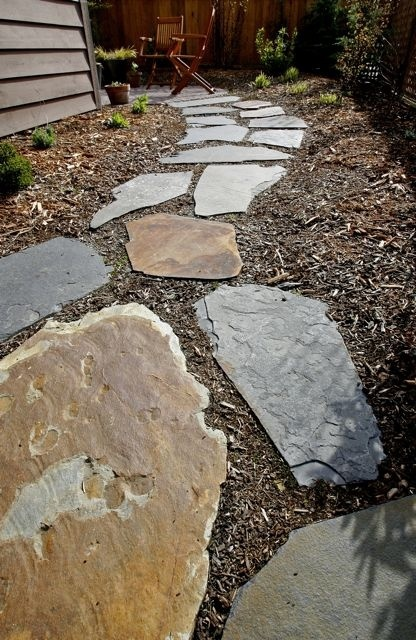 Slate stepping stone pathway. This could be where the pathway starts to break up and enter into the mulch area.