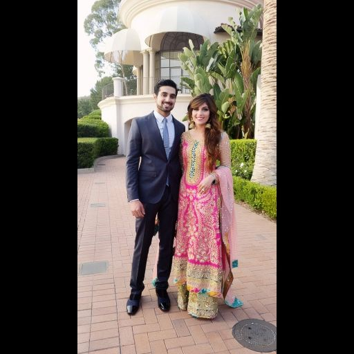 Aamna Mirza on her Mehndi day in a Rani pink and gold handwork Nomi Ansari bridal