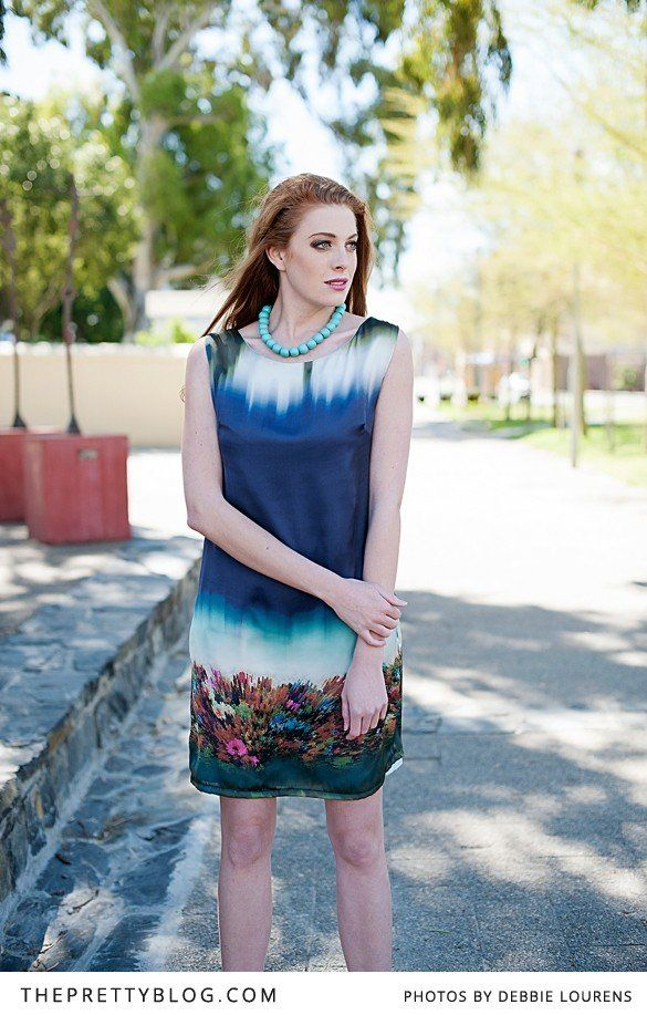 Printed dress in hues of blue   Photographer: Debbie Lourens Photography, Hair & Make-up: Marnel Toerien, Model: Kim Rose de Vries, Stylist: Stephen van Eeden for Rosenwerth, Clothing: Rosenwerth