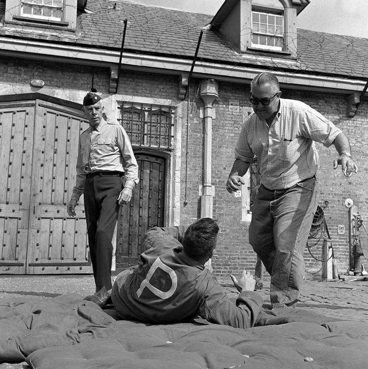 Director Robert Aldrich and Lee Marvin going over a scene in the Dirty Dozen in 1967.